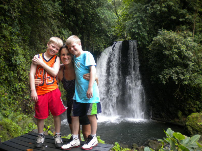 The twins in front of a waterfall